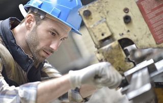 human male working with metal